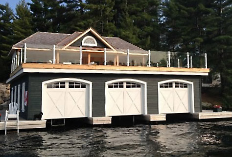 Boat house with a glass railing.