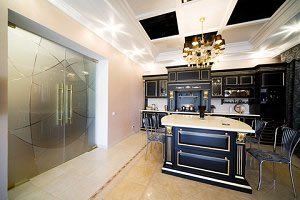 Large double glass doors in a modern kitchen.