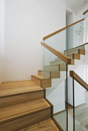 Glass railing with wood handrail.