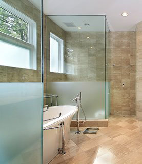 Glass shower in an upscale bathroom.
