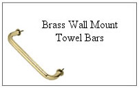 Brass wall mount towel bar.