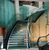 Commercial glass railing in office building.